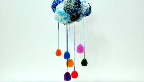 pom poms rainbow rain cloud yarn wall decoration art craft diy tutorial kids play ideas fun