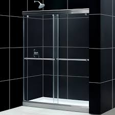 modern bathroom design with black merola tile wall and rain shower plus  dreamline shower doors