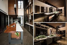 this long and modern kitchen island is home to a bar a six person dining