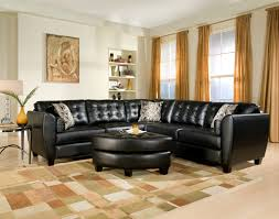 Living Room Black Leather Sectional Sofa And Round Ottoman With