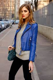 dazzling blue cropped jacket a grey sweater and black jeans