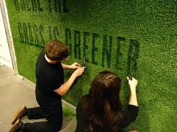 fake grass wall cut by hand out of a x sheet of fake grass to promote our fake grass wall
