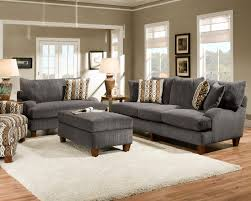 regal contemporary living room design with grey fabric sofa feat square upholstery ottoman coffee table on white fur rug as inspiring contemporary gray