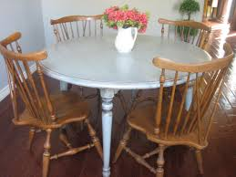 round white wooden dining table and brown wooden dining chairs on