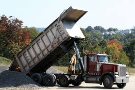 Image result for tip truck in operation