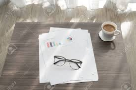 Office Table With Modern Glasses On Business Report Chart Paper