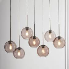 sculptural glass 7 light linear chandelier small globe smoke shade bronze canopy