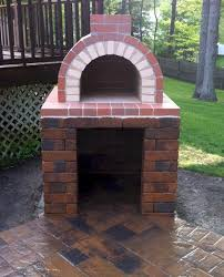 a perfectly constructed diy wood fired brick oven this oven features a hardscape block