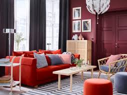 red living room chairs. a grey and dark red living room with orange sofa, striped rug rattan chair chairs