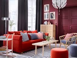living room furniture ikea. a grey and dark red living room with orange sofa striped rug rattan chair furniture ikea
