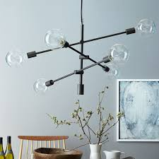 this west elm mobile chandelier remains simple functional yet so fun plus the arms are adjule to create the perfect lighting for your next dinner