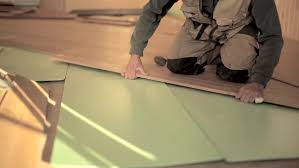 Builders Man Install In Construction House Laying Laminate Floor.   HD  Stock Video Clip