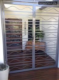 3 steel security doors grilles