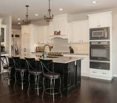custom kitchen in maple cabinets off white finishes and black painted island