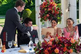 best man presents gift to bride at reception syon park great conservatory