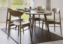 graham and green have looked to the past for the inspiration behind the 50s style dining table and chairs recently added to their