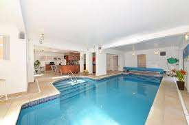 mansion bedrooms with a pool. The House Features An Unusual Kitchen Feature - A Swimming Pool Mansion Bedrooms With E