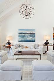 orb chandelier living room transitional with area rugs cathedral ceiling hardwood floors living