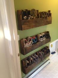 DIY Shoe Storage Ideas like this Dyi shoe rack made out of pallets.