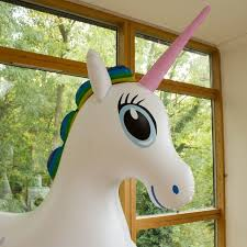 life size unicorns your living room demands it a life size inflatable unicorn geekologie