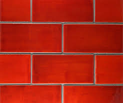 there is a richness of colour and texture to the glazed tiles that machine made tiles just cannot match