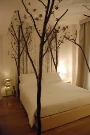 Love the tree branch bed posts ind this bedroom @istandarddesign
