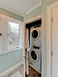 washer and dryer view full size neat cupboard off bathroom with stackable