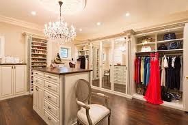 Example of a large transitional women's brown floor walk-in closet design  in Los Angeles