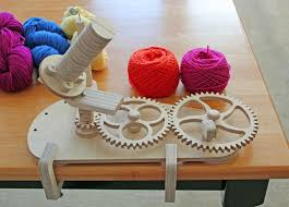 ball winder from above notice the nice crosswound center pull cake it makes this is worsted weight yarn
