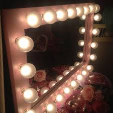 paris pink lighted vanity mirror use to apply make up hair