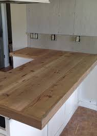 diy reclaimed wood countertop adding trim boards along edge