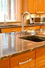 kitchen dark black and gold granite countertops matching the prep sink faucet to the kitchen sink faucet