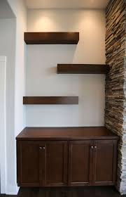 floating shelves by fireplace