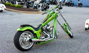 green naked chopper motorcycle on parking lot free stock photo