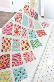 Lattice Baby Quilt Tutorial & The step-by-step process for a simple baby quilt, that is perfect for using  up charm-squares or showing off your favorite fabrics. Adamdwight.com