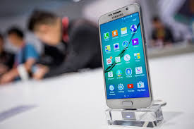 samsung phones touch screen android with price 2015. visitors analyze the samsung galaxy s6 at fira gran via for mobile world congress 2015 phones touch screen android with price