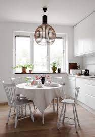 white kitchen with square tiles nordic style white kitchen round dining table scandinavian interior living room