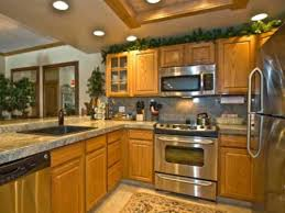 Small Picture Granite and Stainless Appliances in Kitchen with Oak Cabinets
