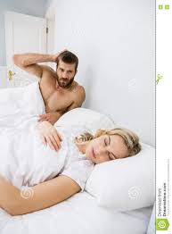 Men And Women In Bedroom Aggressive Man Looking At Woman Sleeping In Bed Stock Photo