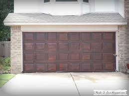contemporary garage to faux wood garage doors