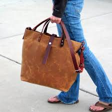 waxed canvas tote with leather handles and detachable leather image 0