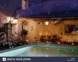 french house lighting. Lights Around Swimming Pool Of French Country House With Table Set For Candlelit Dinner On Veranda Lighting L