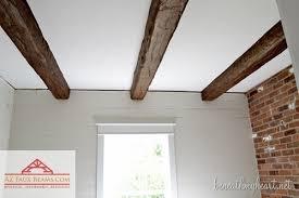 faux exposed wood beam ceilings