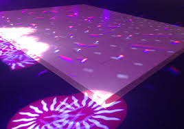 white dance floor hire with scan lights