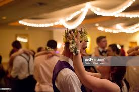 Bailey Atwood adjusts Dustin Crawford's prom king crown as they dance...  News Photo - Getty Images