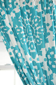 Papercut Medallion Curtain #UrbanOutfitters Love the bright teal color...just  not long