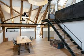 farmhouse renovation with exposed wood trusses naturally mixes old and new