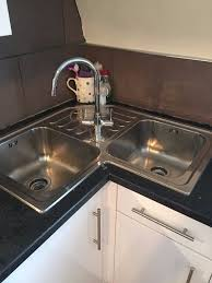 stunning corner top mount stainless steel double bowl sink chrome single handle faucet black marble countertop white base cabinet