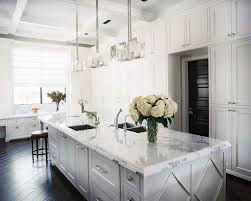 white kitchen cabinets with dark wood floors kitchen with floor to white carrera marble countertops
