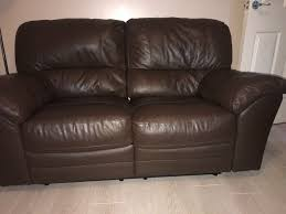 pair of two seater chocolate colour leather sofas